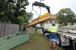 PIC 12 FLOOR BEARERS AND JOISTS BEING UNLOADED INTO SITE